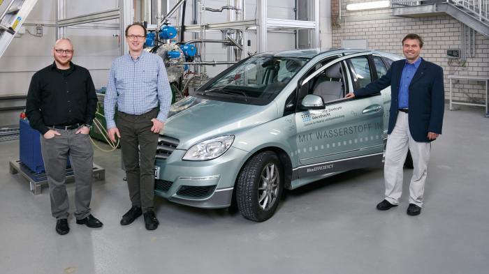 Scientists with hydrogen car.